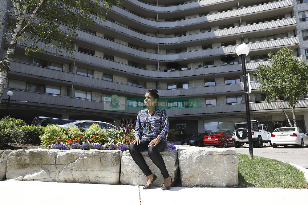 July 4, 2018 - Toronto, ON, Canada - TORONTO, ON - July 4: Nalenie Persaud in front of her apartment building at 1350 Danforth Ave. The single mother of two teenagers who has a part-time job in the film industry and relies on welfare to fill in the gaps, has been on Toronto's affordable housing wait list for 10 years. She struggles to pay $1,000 a month for her two-bedroom apartment and doesn't know what to do if her landlord succeeds in evicting her this month. July 4, 2018. Randy Risling/Toronto Star (Credit Image: © Richard Lautens/The Toronto Star via ZUMA Wire)