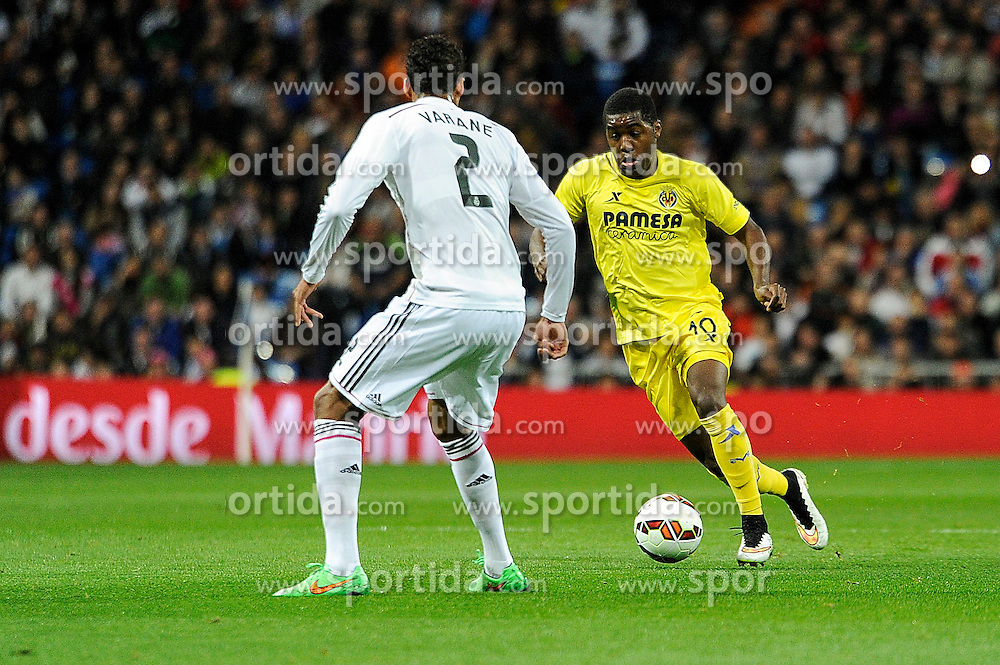 01.03.2015, Estadio Santiago Bernabeu, Madrid, ESP, Primera Division, Real Madrid vs FC Villarreal, 25. Runde, im Bild Real Madrid&acute;s Raphael Varane and Villarreal CF&acute;s Joel Campbell // during the Spanish Primera Division 25th round match between Real Madrid CF and Villarreal at the Estadio Santiago Bernabeu in Madrid, Spain on 2015/03/01. EXPA Pictures &copy; 2015, PhotoCredit: EXPA/ Alterphotos/ Luis Fernandez<br /> <br /> *****ATTENTION - OUT of ESP, SUI*****