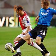 NLD/Amsterdam/20060823 - Ajax - FC Kopenhagen, Wesley Sneijder in duel met Michael Silberbauer