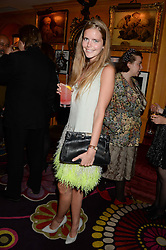 KATIE READMAN at an exhibition of the 50 best party pictures from Tatler from the past 50 years, held at Annabel's, Berkeley Square, London on 9th September 2013.
