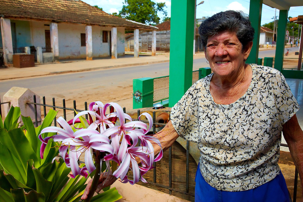 Woman with flowers in San Felipe, Mayabeque, Cuba.
