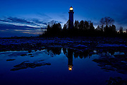 Dusk at the Cana Island Lighthouse on Lake Michigan in Door County, Wisconsin.  (Photo by Mike Roemer)