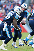 NASHVILLE, TN - OCTOBER 25:  Zach Mettenberger #7 hands off the ball to Antonio Andrews #26 of the Tennessee Titans during a game against the Atlanta Falcons at Nissan Stadium on October 25, 2015 in Nashville, Tennessee.  The Falcons defeated the Titans 10-7.  (Photo by Wesley Hitt/Getty Images) *** Local Caption *** Antonio Andrews; Zach Mettenberger