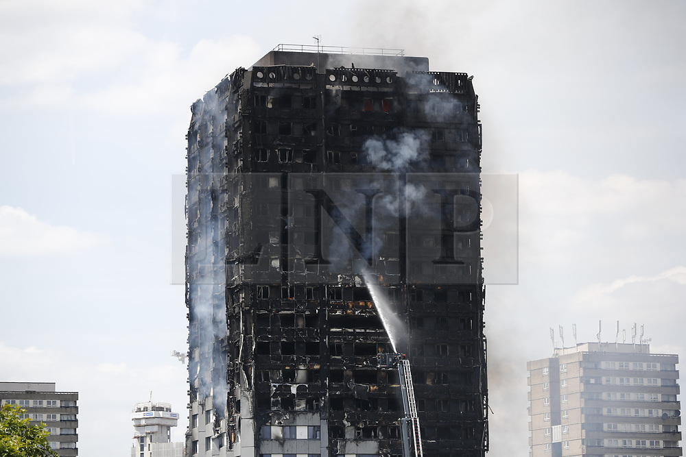 © Licensed to London News Pictures. 14/06/2017. London, UK. Fire engines try to get the Grenfell Tower fire under control 13 after the fire broke in west London on 14 June 2017. Photo credit: Tolga Akmen/LNP