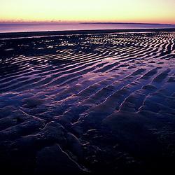 Patterns on a frozen beach at sunrise.  Parker National Wildlife Refuge, Plum Island, Massachusetts