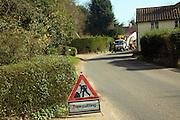 Red triangular road sign warning of tree cutting work, Shottisham, Suffolk, England, UK