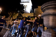 Roma 25 Giugno 2010.Manifestazione Pro-Palestina sulle scale del Campidoglio,la rete romana di solidarieta' con il popolo palestinese  ha acceso delle piccole candeline per il popolo palestinese in contrapposizione al comune di Roma  che spegne le luci del Colosseo per la liberazione del militare israeliano sequestrato da 4 anni da Hamas..Appartenenti alla comunità ebraica aggrediscono la manifestazione pro-Palestina.Rome June 25, 2010.Pro-Palestinian demonstration on the steps of the Capitol, the Roman system of sympathy 'with the Palestinian people lit small candles for the Palestinian people as opposed to the municipality of Rome off the lights of the Coliseum for the release of Israeli soldier abducted by four years Hamas.Belonging to the Jewish community attack the pro-Palestinian demonstration