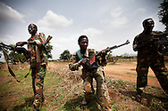 SPLA soldiers near Dalami show off weapons they captured in a recent battle with SAF troops. The SPLA say they have surrounded Dalami and cut off all suplly lines except by helicopter. All civilians have fled the city, many are hiding in caves behind SPLA lines.