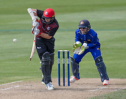 Canterbury's Tom Latham, left, bats as Otago Volts' Derek de Boorder keeps wicket in the Ford Trophy one-day domestic cricket match at the University of Otago Oval, Dunedin, New Zealand, Saturday, January 27, 2018. Credit:SNPA / Adam Binns ** NO ARCHIVING**