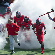 September 06, 2014:  Rutgers Scarlet Knights head coach Kyle Flood leads his team through the smoke and onto the field for Rutgers Scarlet Knights first Big 10 home game  during the game between The Howard Bison and Rutgers Scarlet Knights at Highpoint Solutions Stadium in Piscataway, NJ.  Rutgers Scarlet Knights defeated Howard Bison 38-25. Mandatory Credit: Kostas Lymperopoulos/CSM, (Credit Image: © Kostas Lymperopoulos/Cal Sport Media)