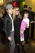 Kate Moss,  Meg Mathews and Anias,  Shanghai Tang opening. Sloane St. 11 April 2001. © Copyright Photograph by Dafydd Jones 66 Stockwell Park Rd. London SW9 0DA Tel 020 7733 0108 www.dafjones.com