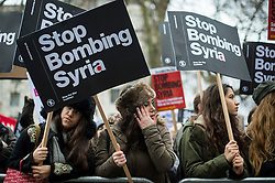 © Licensed to London News Pictures. 12/12/2015. London, UK. Protestors take part in a Stop The War Coalition demonstration in central London against the UK's bombing campaign in Syria. The march begins at the BBC headquarters and passes Downing Street in Westminster.  Photo credit: Ben Cawthra/LNP