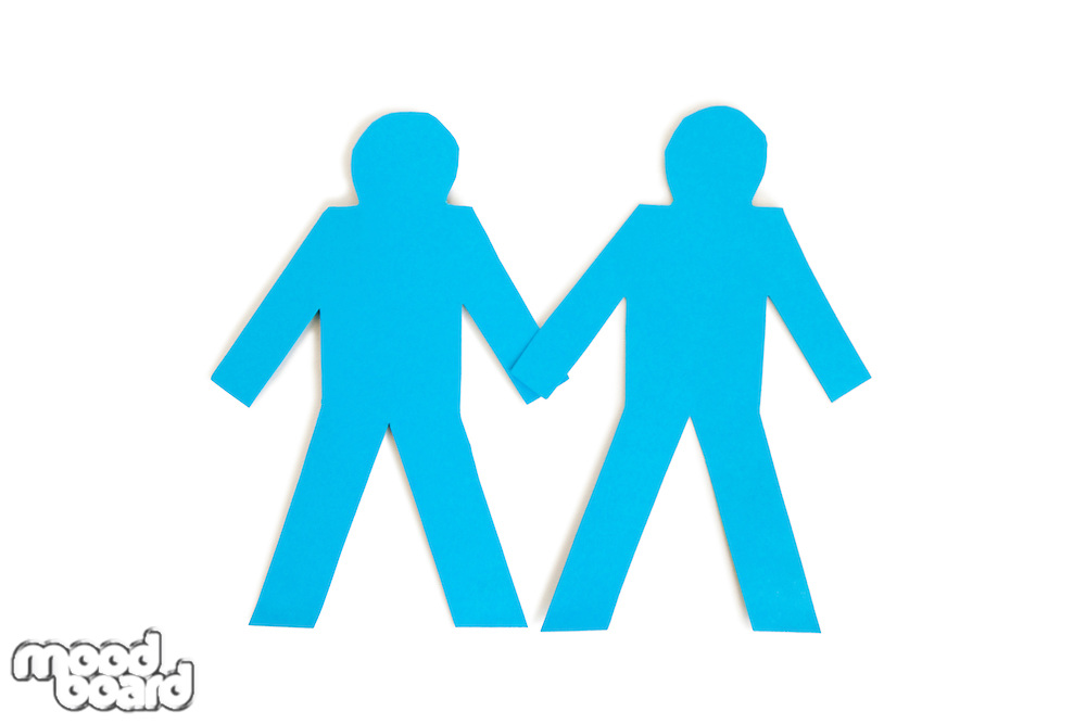 Two blue paper stick figures holding hands over white background