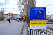 The sign to the EU funded rebuilt Mitrovica bridge, over the river Ibar which separates the Serbian and Albanian districts of Mitrovica, Kosovo on the 12th of December 2018. Mitrovica or Kosovska Mitrovica is a city and municipality located in Kosovo. Settled on the banks of Ibar and Sitnica rivers, the city is the administrative center of the Mitrovica District.  (photo by Andrew Aitchison / In pictures via Getty Images)