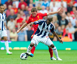 WEST BROMWICH, ENGLAND - Saturday, August 18, 2012: Liverpool's Joe Allen in action against West Bromwich Albion's Youssuf Mulumbu during the opening Premiership match of the season at the Hawthorns. (Pic by David Rawcliffe/Propaganda)