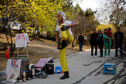 BEIJING, CHINA -  (CHINA OUT) <br /> <br /> Kung Fu Grandpa<br /> <br /> An 80-year-old man performs his stunts at Yuyuantan Park  in Beijing, China. An 80-year-old, gray-haired man performs kungfu and feats of balance, exposing his sculpted abs and drawing envious looks from passersby in a park in Beijing. The extraordinary physical stunts not only make the octogenarian a living, but also bring him a lot of joy. ©Exclusivepix Media