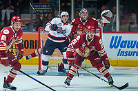 REGINA, SK - MAY 27: Nick Henry #21 of Regina Pats checks Michal Ivan #29 behind Samuel Asselin #28 in front of the net of Evan Fitzpatrick #31 of Acadie-Bathurst Titan at the Brandt Centre on May 27, 2018 in Regina, Canada. (Photo by Marissa Baecker/CHL Images)