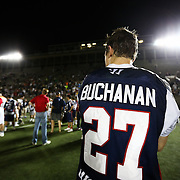 Kevin Buchanan #27 of the Boston Cannons is seen on the field following the game at Harvard Stadium on August 9, 2014 in Boston, Massachusetts. (Photo by Elan Kawesch)