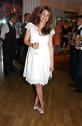 LAUREN BOOTH at a party hosted by Elizabeth Saltzman and Harvey Nichols to celebrate the UK launch of New York fashion designer Tory Burch held at the Fifth Floor Restaurant, Harvey Nichols, Knightsbridge, London on 24th May 2006.<br /><br />NON EXCLUSIVE - WORLD RIGHTS