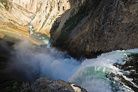 Looking down from the top of Yellowstone Falls as the water flows into the Grand Canyon of Yellowstone, Wyoming, USA.