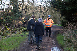 Denham, UK. 11 February, 2020. Environmental activists from Save the Colne Valley and Stop HS2 speak to an enforcement agent working on behalf of HS2 at Denham in the Colne Valley. HS2 are rerouting electricity pylons through a Site of Metropolitan Importance for Nature Conservation (SMI) in conjunction with the high-speed rail link.