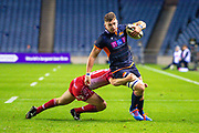 Magnus Bradbury (#20) of Edinburgh Rugby looks to break the tackle of Jonathan Evans (#21) of Scarlets during the Guinness Pro 14 2019_20 match between Edinburgh Rugby and Scarlets at BT Murrayfield Stadium, Edinburgh, Scotland on 26 October 2019.