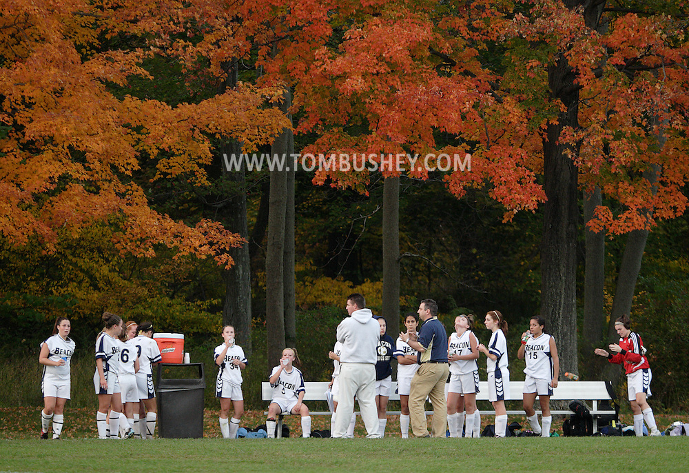 Beacon, NY - A coach talks to his players as they sit under a colorful tree at halftime of a high school girls' soccer game in Beacon on Oct. 14, 2008.
