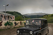 A military jeep from the Nagorno-Karabakh armed forces approaches a base on Sunday, May 8, 2016 in Talish, Nagorno-Karabakh. Due to intense nearby fighting in early April, the entire village has been evacuated of civilians.