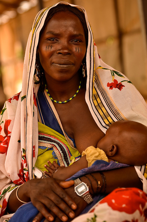 Mariam Yacoub, 30, waits with her baby Farajan Moudena Koley to be seen by a doctor at a free clinic in Gouroukoun IDP camp outside of Goz Beida, Chad.  Radio Sila journalist, Madjihinguem Nguinabe visited the clinic while working on a story about the debate between IDPs to stay or return to their homes.