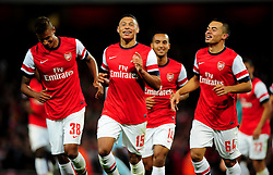 Arsenal's Alex Oxlade-Chamberlain celebrates his wonder goal with Arsenal's Nico Yennaris and Arsenal's Martin Angha - Photo mandatory by-line: Joe Meredith/JMP  - Tel: Mobile:07966 386802 26/09/2012 - Arsenal v Coventry City  - SPORT - FOOTBALL - Capital One League Cup -  London  - Emirates Stadium