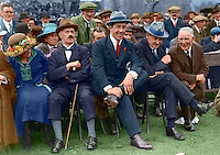 Second from left to right: Eamon Duggan, Harry Boland and Michael Collins attend a match in Croke Park, 1921. This image has been digitally edited to add colour to its original black and white format.  (Part of the Independent Newspapers Ireland/NLI Collection)
