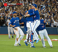 Oct 14, 2015; Toronto, Ontario, CAN; Toronto Blue Jays team celebrate win against Texas Rangers in game five of the ALDS at Rogers Centre. Mandatory Credit: Peter Llewellyn-USA TODAY Sports