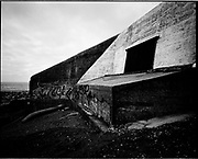 THE ATLANTIC WALL. .pic shows: REMAINS OF BLOCKHOUSE AT AUDRESSELLES SOUTH OF CAP GRIS-NEZ BETWEEN CALAIS AND BOULOGNE..WORLD WAR TWO ENDED IN EUROPE IN MAY 1945, THIS YEAR SEES THE 60th ANNIVERSARY OF THAT VICTORY..THE ATLANTIC WALL BUILT BY GERMANY IN WORLD WAR 2 STRETCHED FROM NORWAY VIA DENMARK, HOLLAND, BELGIUM AND FRANCE TO THE SPANISH BORDER. THE MAIN CONCENTRATION OF BUNKERS,BLOCKHOUSES AND DEFENCES WERE ALONG THE DUTCH, BELGIAN AND FRENCH COASTAL AREAS MOST UNDER THREAT FROM AN ALLIED INVASION. THE CONSTRUCTION OF THE WALL BEGAN IN 1942 AND CONTINUED UP UNTIL THE JUNE 6th ALLIED INVASION ON D-DAY IN 1944..TENS OF THOUSANDS OF WORKERS AND PRISONERS FROM THE GERMAN OCCUPIED AREAS OF EUROPE WERE EMPLOYED BY THE ORGANISATION TODT NAMED AFTER FRITZ TODT, THE GERMAN ENGINEER WHO DIED IN 1942 (TO BE SUCEEDED BY ALBERT SPEER) IN THE BUILDING WORK. BETWEEN THE RIVERS LOIRE AND DIVES 87,257 WORKERS WERE USED INCLUDING 55,000 FRENCHMEN, 11,500 GERMANS, 4,200 DUTCH, 6.600 BELGIANS, 2,600 NORTH AFRICANS AND SEVERAL THOUSAND FROM EASTERN EUROPE..THE ATLANTIC WALL WAS THE LARGEST BUILDING PROJECT SINCE THE ROMAN EMPIRE. MANY OF THE COLOSSAL GUN BUNKERS AND UNDERGROUND DEFENSIVE CHAMBERS REMAIN. SOME HAVE FALLEN FROM CLIFF TOP POSITIONS WHILE OTHERS ARE PARTLY CONSUMED BY SAND DUNES. THE RAVAGES OF WAR, TEN THOUSAND TON BOMBS AND 60 YEARS OF COASTAL WEATHER HAVE HARDLY AFFECTED THESE LEVIATHAN LIKE STRUCTURES WHICH LOOK LIKELY TO LAST AS LONG AS THE RUINS OF ANCIENT ROME. A FITTING REMINDER OF A WORLD THAT COULD HAVE BEEN FROM 60 YEARS AGO..COPYRIGHT PHOTOGRAPH BY BRIAN HARRIS  © 2005.07808-579804