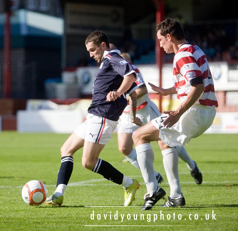 Jamie McCluskley on the ball as Hamilton's Martin Canning watches - Dundee v Hamilton Academical - IRN BRU Scottish Football League First Division at Dens Park..© David Young.5 Foundry Place .Monifieth.DD5 4BB.07765252616.email: davidyoungphoto@gmail.com.http://www.davidyoungphoto.co.uk