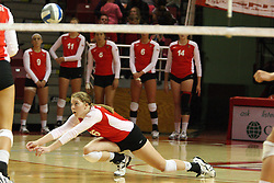 22 September 2012:  Shannon McGlaughlin slides to the floor to dig out a save during an NCAA womens volleyball match between the Bradley Braves and the Illinois State Redbirds at Redbird Arena in Normal IL