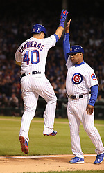 October 18, 2017 - Chicago, IL, USA - The Chicago Cubs' Willson Contreras (40) high-fives third base coach Gary Jones after his second-inning solo home run against the Los Angeles Dodgers during Game 4 of the National League Championship Series at Wrigley Field in Chicago on Wednesday, Oct. 18, 2017. (Credit Image: © Brian Cassella/TNS via ZUMA Wire)