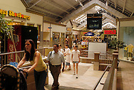 PHILADELPHIA, PA - JUNE 15:  Shoppers navigate through Franklin Mills Mall June 15, 2005 in Philadelphia, Pennsylvania. (Photo by William Thomas Cain)