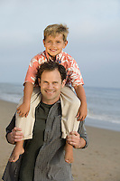 Father with Son on Shoulders at Beach