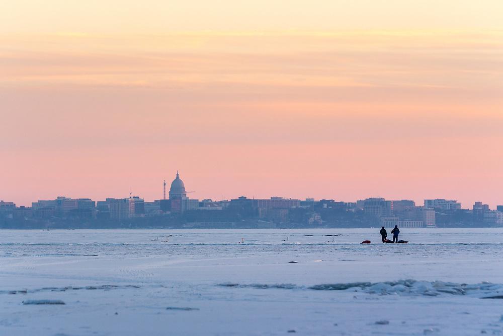 Ice fishing on Lake Mendota in Madison at sunset