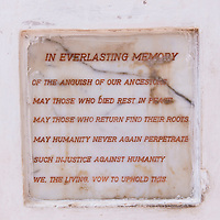 A plaque dedicated to the memory of the injustices which occurred at Cape Coast Castle, a UNESCO World Heritage Site located along the Gold Coast of Ghana.