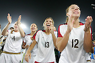21 August 2008: USA bench players Rachel Buehler (USA) (4), Stephanie Cox (USA) (14), Tobin Heath (USA) (13) and Lauren Cheney (USA) (12) cheer on the starters. The United States Women's National Team defeated Brazil's Women's National Team 1-0 after extra time at the Worker's Stadium in Beijing, China in the Gold Medal match in the Women's Olympic Football tournament.