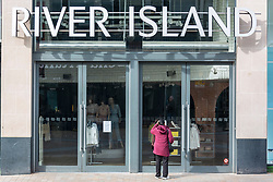 © Licensed to London News Pictures. 21/03/2020. Leeds UK. River Island in Leeds city centre has been closed due to the Covid 19 outbreak. Photo credit: Andrew McCaren/LNP