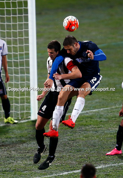 Auckland's Marko Dordevic has a crack at goal ahead of Hawkes Bay's Fin Milne. ASB Premiership, Round One, Auckland City FC v Hawkes Bay United, QBE Stadium Auckland, Thursday 12th November 2015. Copyright Photo: Shane Wenzlick