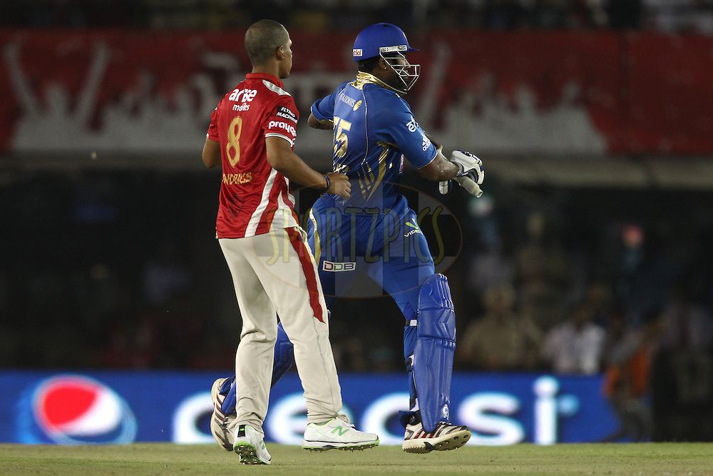 Beuran Hendricks of the Kings XI Punjab and Kieron Pollard of the Mumbai Indians narrowly avoid a collision  during match 48 of the Pepsi Indian Premier League Season 2014 between the Kings XI Punjab and the Mumbai Indians held at the Punjab Cricket Association Stadium, Mohali, India on the 21st May  2014<br /> <br /> Photo by Shaun Roy / IPL / SPORTZPICS<br /> <br /> <br /> <br /> Image use subject to terms and conditions which can be found here:  http://sportzpics.photoshelter.com/gallery/Pepsi-IPL-Image-terms-and-conditions/G00004VW1IVJ.gB0/C0000TScjhBM6ikg