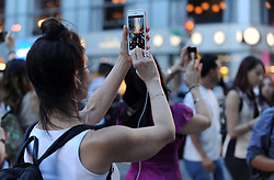 People take photos of a Manhattanhenge event at sunset in New York City, NY, USA on July 12, 2018. The Manhattanhenge sunset comes twice a year when the setting sun aligns precisely with Manhattan's street grid. Photo by Dennis Van Tine/ABACAPRESS.COM