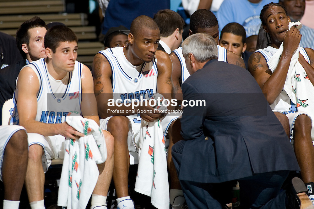 22 November 2005:  UNC head coach Roy Williams speaks with Reyshawn Terry during a Cleveland State 55-112 loss at North Carolina in the Dean Smith Center in Chapel Hill, NC.