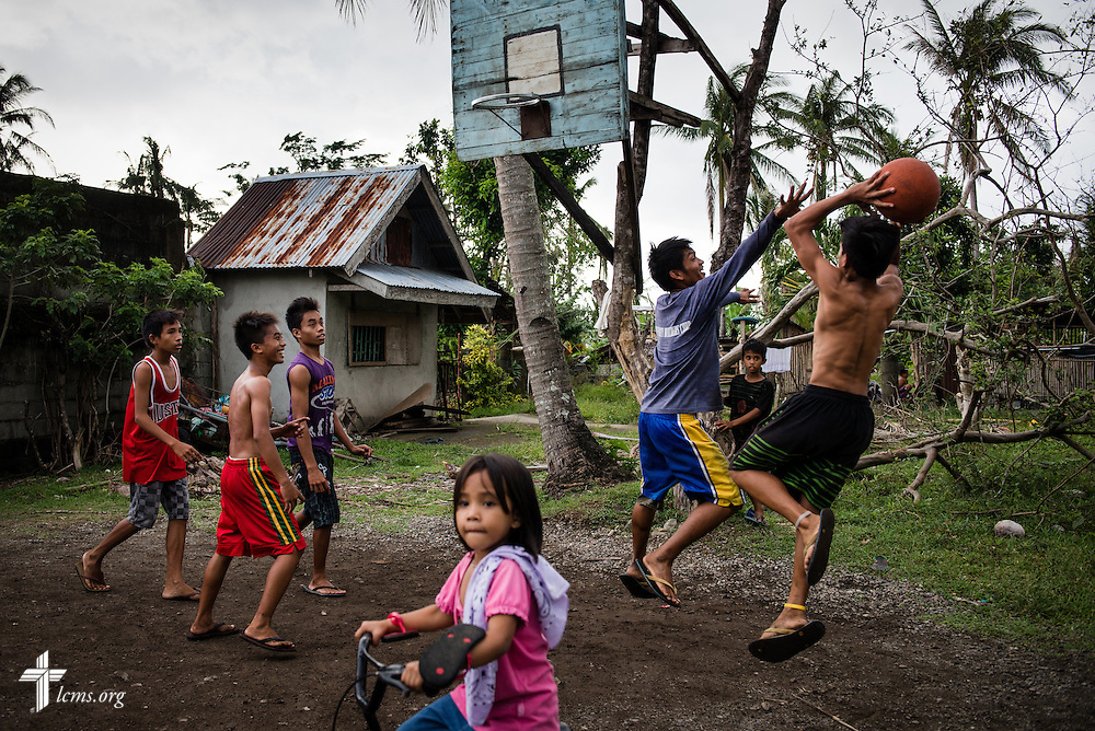 Boys play basketball near Mahayag, Leyte Province, Philippines, on Saturday, March 15, 2014. Slowly, residents begin to recover following Typhoon Haiyan. LCMS Communications/Erik M. Lunsford