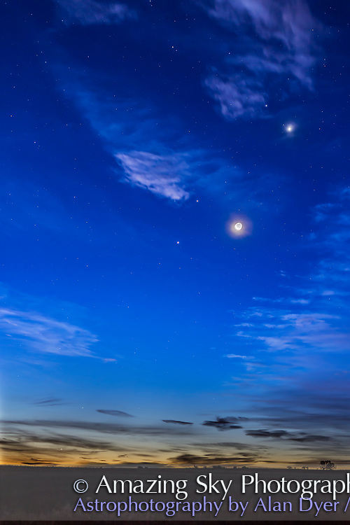 The waning crescent Moon, lit by Earthshine, with four planets on the morning of October 9, 2015, with the planets from bottom left to top right:<br /> &bull; Mercury, just above the horizon between the low cloud bands, at lower left<br /> &bull; Jupiter, bright at centre<br /> &bull; Mars, reddish and above Jupiter<br /> &bull; Venus, brightest at upper right and in some thin cloud. <br /> The bright star Regulus in Leo is above and to the left of Venus.<br /> <br /> This is a blend of four exposures: a long 4-second exposure for most of the sky and ground and shorter 2, 1, amd 1/2 second exposures for the bright twilight area and around the Moon and Venus, to prevent those areas fro being blown out. Blending is with masks, not HDR. All with the Canon 6D at ISO 400 and 50mm Sigma lens at f/2.5