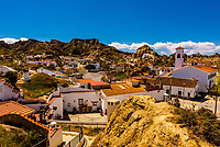 Cave houses and Rock formations, Barrio de Cuevas, Guadix, Granada Province, Andalusia, Spain.