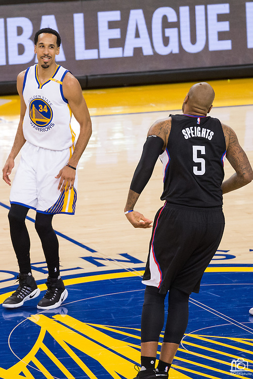Golden State Warriors guard Shaun Livingston (34) smiles at LA Clippers center Marreese Speights (5) after blocking his shot during the fourth quarter at Oracle Arena in Oakland, Calif., on February 23, 2017. (Stan Olszewski/Special to S.F. Examiner)